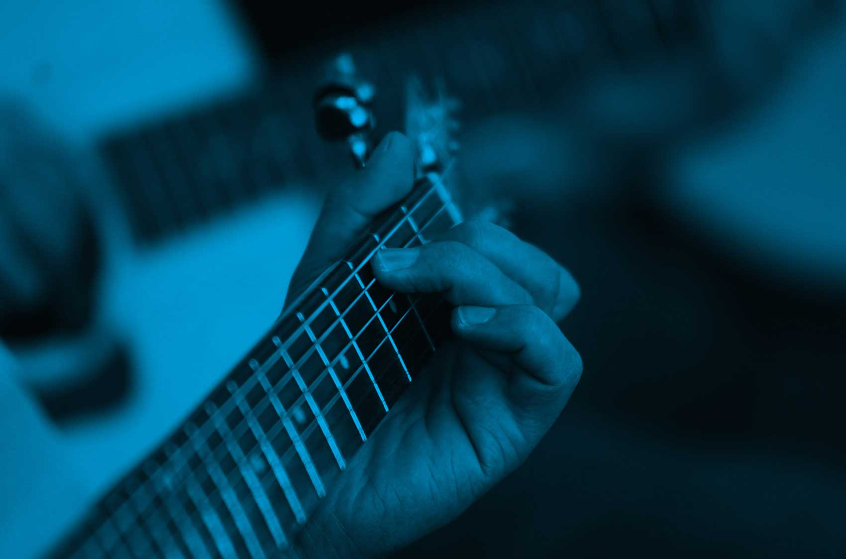 Background image showing a guitar